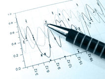 Pen against the graph (in blue) Royalty Free Stock Images