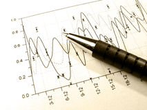 Pen Against The Graph (in Sepia) Royalty Free Stock Photos