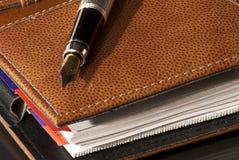 Pen & agenda Stock Photos