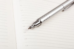Pen and agenda Stock Photo