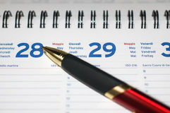 Pen on agenda. With month days and dates Royalty Free Stock Photo