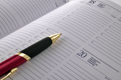 Pen on agenda page Stock Image