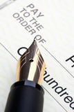 Pen And Check Stock Image