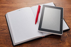 Pen And Tablet On Open Notes At The Wooden Desk Stock Images