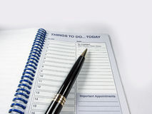 Pen and appointment notebook. For the appointments of today...Things to do today Royalty Free Stock Photography