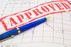 Pen in approved doc. Blue pen in approved doc royalty free stock photography
