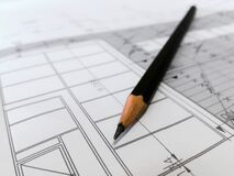 Pen on architectural drawing Royalty Free Stock Photography