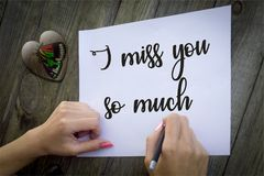 I miss you so much illustration foto. A pen,arms,background,concept,creativity,design,foto,happy,learning,letters,notebook,paper,people,tablebackground,black royalty free illustration
