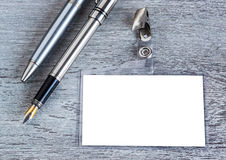 Pen, badge, blank ID card , badge. Pen, badge, blank ID card or security, macro, view from above Royalty Free Stock Photography