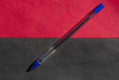 Pen. Ballpoint pen on a blue double-colored background paper Stock Images
