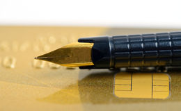 Pen on bank card Stock Images