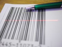 Pen and barcode. Background on white stock images