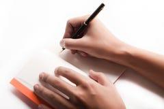 Pen is being held in hand Stock Photos