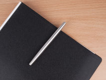 Pen  and  black folder Stock Photo