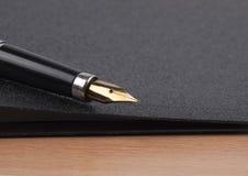 Pen  and  black folder Stock Image