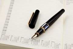 Pen. Black and gold pen on notepad Royalty Free Stock Photo