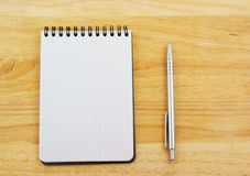 Pen and blank note pad Stock Images