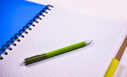 Pen on blank notebook Stock Image