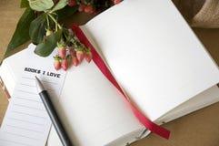 Pen on blank notebook Stock Photos