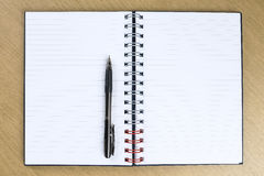 Pen and blank opened notebook Royalty Free Stock Photos