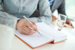 Pen on blank page Stock Image