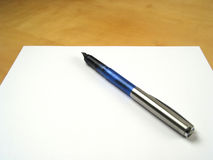 Pen on blank paper Stock Images