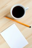 Pen, blank paper on board and cup of coffe Royalty Free Stock Photos