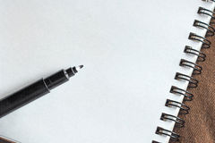 Pen on blank paper Royalty Free Stock Image
