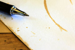 Pen with blank white paper on wooden Stock Photos