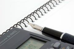 Pen, blocnote en calculator Royalty-vrije Stock Afbeelding