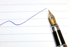 Pen and blue curve Stock Images
