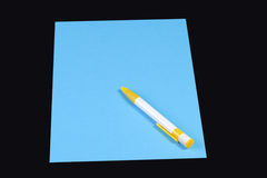 Pen on blue paper Royalty Free Stock Photography