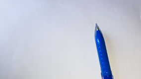 Pen. Blue Pen placed on a White paper Royalty Free Stock Photos