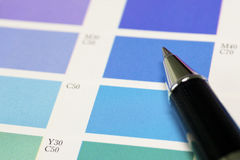 A pen and blue process color chart. For designer reference royalty free stock photography