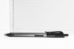 Pen and blur white notebook paper Stock Image