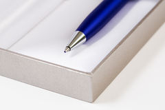 Pen with body on block of papers Royalty Free Stock Photography
