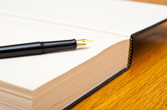 Pen and book Royalty Free Stock Images