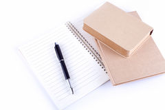 Pen on Book. Pen on a white background books for recycling Royalty Free Stock Photos