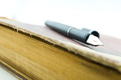 Pen on book Royalty Free Stock Image