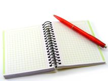 Pen and a book. Red pen and blank notebook Royalty Free Stock Images