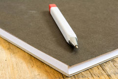 Pen on book Stock Images