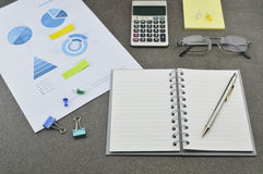 Pen, book, calculator, glasses and financial chart and graph Royalty Free Stock Image