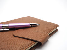 Pen and book leatherette on white background. For artwork Stock Photography