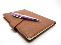 Pen and book leatherette on white background Royalty Free Stock Photography