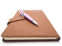 Pen and book leatherette on white background Stock Images