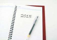 A pen on a book with 2015 on it. A pen on a book with phrase 2015 on it Stock Photos