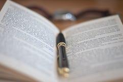 Pen in the book Stock Photos