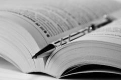 Pen In Book Stock Photo