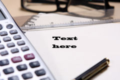 Pen ,book, ruler, calculator and glasses Royalty Free Stock Photography