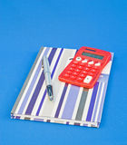 Pen, book and solar calculator. A close up image of a note book , fountain pen and solar powered calculator. An arrangement for updating family finances vector illustration